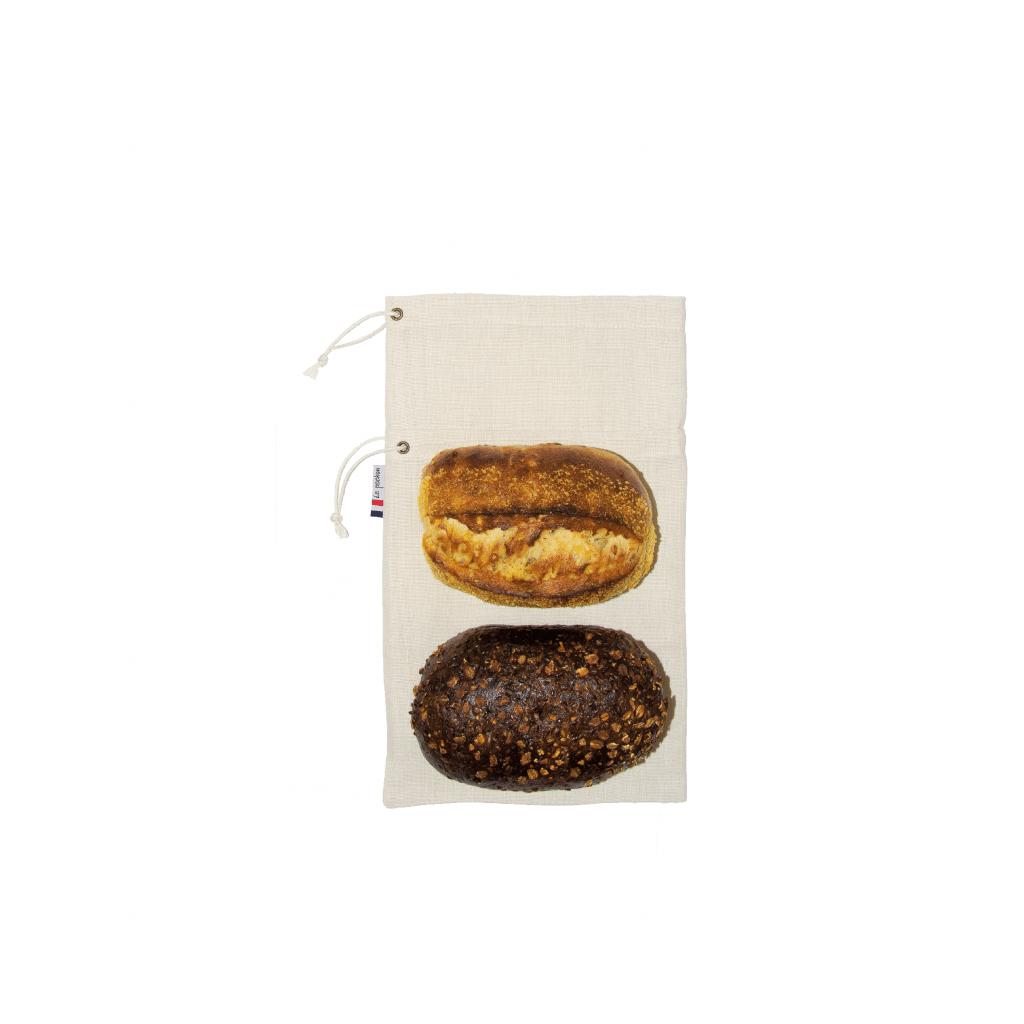 """Sac à pain """"Le Pochon"""" beige avec 2 pains posés dessus : un pain viking et un pain au maïs"""